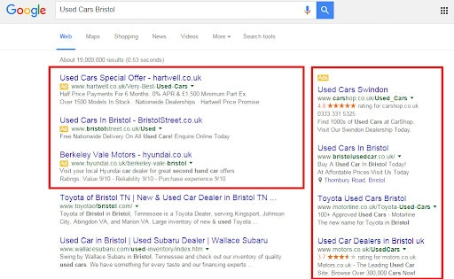 A SERP showing placements for SEO vs SEM.